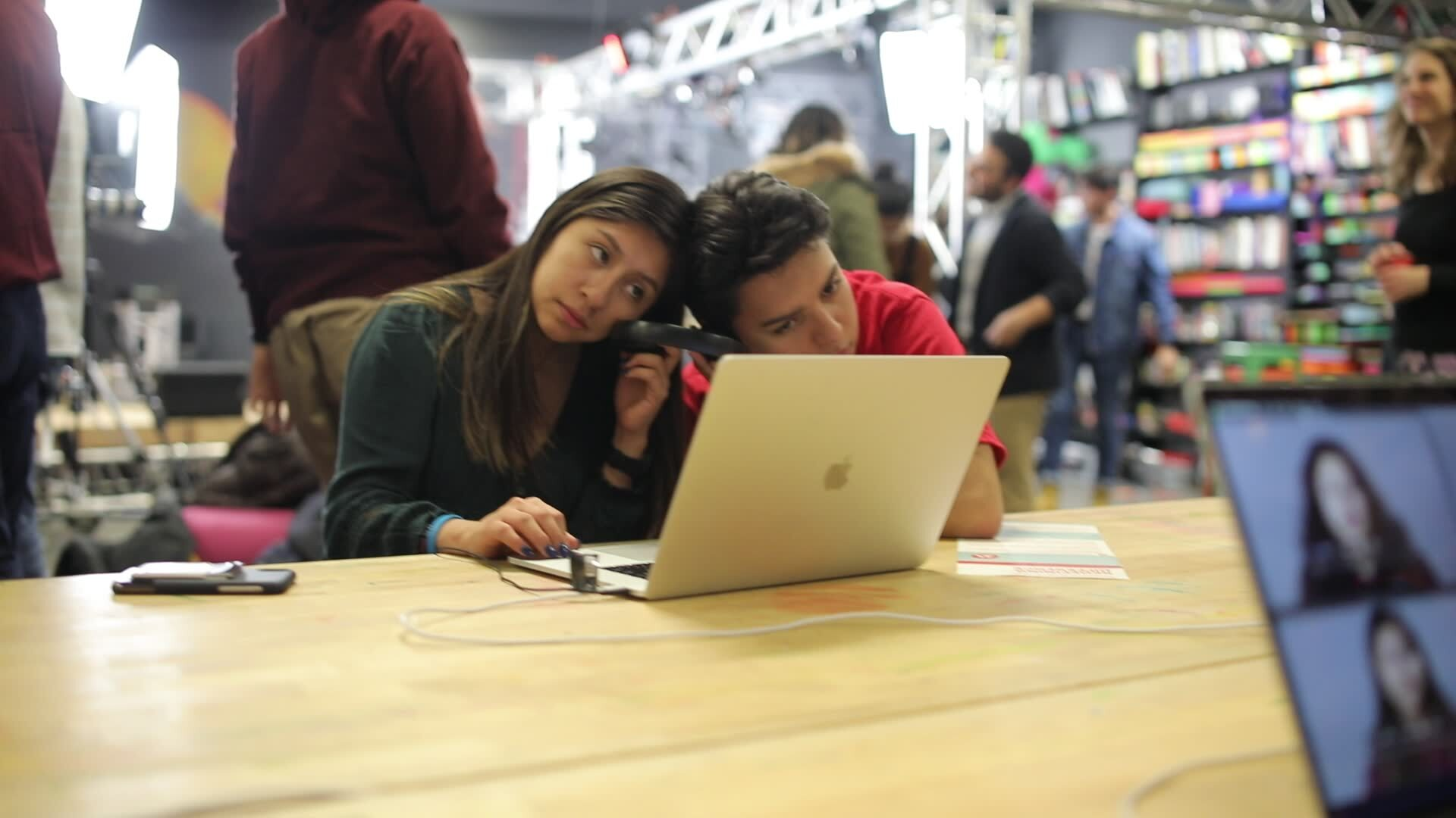 two students listen to Capstone projects together